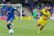 AFC Wimbledon defender Luke O'Neill (2) battles for possession with Wycombe Wanderers midfielder Scott Kashket (11) during the EFL Sky Bet League 1 match between AFC Wimbledon and Wycombe Wanderers at the Cherry Red Records Stadium, Kingston, England on 31 August 2019.
