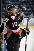 KELOWNA, CANADA, FEBRUARY 17: cody Sylvester #16 of the Calgary Hitmen stands at the bench at the Kelowna Rockets on February 17, 2012 at Prospera Place in Kelowna, British Columbia, Canada (Photo by Marissa Baecker/Shoot the Breeze) *** Local Caption ***