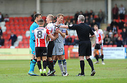James McKeown of Grimsby Town has words with Danny Wright of Cheltenham Town  - Mandatory by-line: Nizaam Jones/JMP - 17/04/2017 - FOOTBALL - LCI Rail Stadium - Cheltenham, England - Cheltenham Town v Grimsby Town - Sky Bet League Two