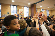 Mayor-Elect Bill de Blasio high-fives students after he announces his appointment of Carmen Fariña as Schools Chancellor at William Alexander Middle School in Park Slope, Brooklyn, NY on Monday, Dec. 30, 2013.<br /> <br /> CREDIT: Andrew Hinderaker for The Wall Street Journal<br /> SLUG: NYSTANDALONE