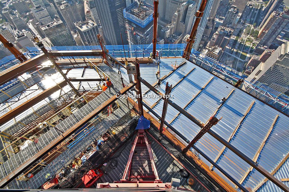 Ninety floors... and counting: The breathtaking views from One World Trade Center (and there's still 14 storeys to go)<br /> <br /> When it is completed, it will be the tallest building in Manhattan and one of incredible poignancy for New York City.&nbsp;<br /> One World Trade Center reached its 90th floor this week - with just 14 more floors to go until the top. The structure can now be seen from all five boroughs of the city. <br /> Stunning pictures showed how the area has been reborn since the 9/11 attacks more than a decade ago where almost 3,000 people lost their lives in the worst ever terrorist attack on American soil.<br /> One World Trade Center is on track to be completed by 2013 with construction workers approximately finishing a floor a week in downtown Manhattan.<br /> Electrical contractors at the tower agreed to give it a festive feel and wrapped the exterior lamps they use with coloured cellophane in time for Christmas.&nbsp; <br /> <br /> Developments can be followed on One World Trade Center's Twitter feed @WTCProgress. Glass now covers up to the 65th floor and concrete has been added up to the 82nd level. There will be 104 floors in the completed building, making it the tallest in Manhattan.<br /> The site will be a place of reflection and contemplation for many and The National September 11 Memorial And Museum, designed by the winning team of Michael Arad and Peter Walker, was opened for the 10th anniversary of the terrorist attacks.<br /> One World Trade Center, designed by renowned architect David Childs, standing in the north-west corner, is the site&rsquo;s centrepiece. The first cornerstone was laid down on July 4 2004 and as the building rose it was known as Freedom Tower.<br /> <br /> It stands in the footsteps of the original twin towers among a small forest of oak trees in an eight-acre plaza. It features two 50ft-deep pools, each containing fountains, along with a museum with exhibitions and artefacts to teach visitors about the events