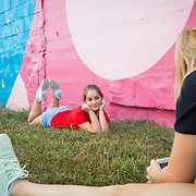 Olivia King,17, takes a picture of her friend, Cira Bickford, 16, in front of a massive mural painted on the side of a former grain mill in downtown Hagerstown, Maryland, on Tuesday, September 26, 2017. Originally a District that was mostly rural, but included towns like Frederick and Hagerstown, Maryland's 6th District was redistricted in 2011, combining rural northern Maryland regions with more affluent communities like near Washington D.C. turning the district from Republican to Democrat. <br />  <br /> CREDIT: John Boal for The Wall Street Journal<br /> GERRYMANDER