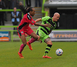 Dover Athletic's Ricky Modeste challenges Forest Green Rovers's David Pipe for the ball - Photo mandatory by-line: Nizaam Jones - Mobile: 07966 386802 - 25/04/2015 - SPORT - Football - Nailsworth - The New Lawn - Forest Green Rovers v Dover - Vanarama Conference League