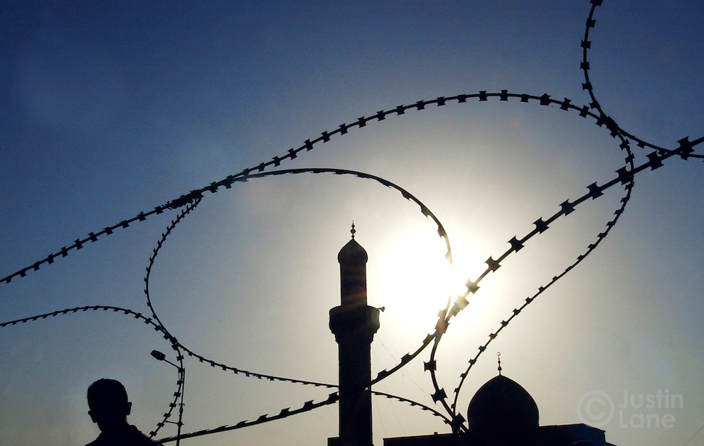 Barbed wire surrounds a mosque in Baghdad.