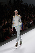 Light blue pants and a patterned top by Richard Chai at the Spring 2013 Mercedes Benz Fashion Week show in New York.