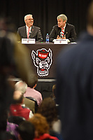 Chancellor Randy Woodson (left) laughs as new athletics director Boo Corrigan answers a question during a press conference in Reynolds Coliseum.