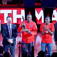 20 April 2016: Los Angeles Clippers guard Jamal Crawford (11) receives the Sixth Man Of The Year Award next to Kevin McHale, his older son Eric, and Los Angeles Clippers head coach Doc Rivers prior to the Los Angeles Clippers 102-81 victory over the Portland Trail Blazers, during Game Two of the Western Conference Quarterfinals of the NBA Playoffs at the Staples Center, Los Angeles, California, USA.
