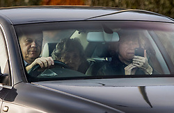 © Licensed to London News Pictures. 22/12/2017. Ashford, UK. Damian Green arrives at his home near Ashford as his wife Alicia (R) appears to be filming the reporters gathered outside. The former First Secretary of State was sacked after he broke the ministerial code. Mr Green had been under investigation after pornographic images were found on his Parliamentary computer and allegations of inappropriate advances towards a female activist were made. Photo credit: Peter Macdiarmid/LNP