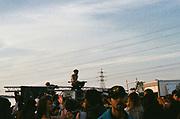 Ravers cheer on entertainers, Avonmouth, Bristol, UK, June 2014