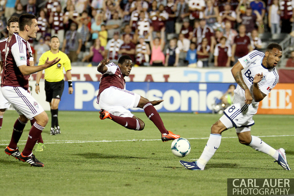 August 17th, 2013 - Colorado Rapids forward Deshorn Brown (26) has his shot attempt blocked by Vancouver Whitecaps FC midfielder Matt Watson (8) in the second half of the Major League Soccer match between the Vancouver Whitecaps FC and the Colorado Rapids at Dick's Sporting Goods Park in Commerce City, CO