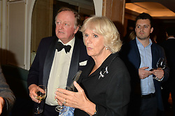 HRH The DUCHESS OF CORNWALL and her ex husband ANDREW PARKER BOWLES at a party to celebrate the publication of 'Let's Eat meat' by Tom Parker Bowles held at Fortnum & Mason, Piccadilly, London on 21st October 2014.