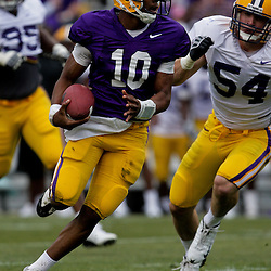 April 2009: LSU Tigers quarterback Russell Shepard (10) runs away from LSU defender Jacob Cutera (54) during the 2009 LSU spring football game at Tiger Stadium in Baton Rouge, LA.