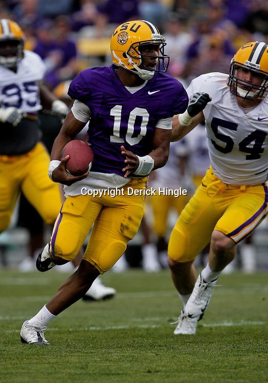 April 2009: LSU Tigers quarterback Russell Shepard (10) runs away from LSU defender Jacob Cutera (54) during the 2009 LSU spring football game at Tiger Stadium in Baton Rouge, LA.