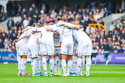 Leeds United huddle during the EFL Sky Bet Championship match between Millwall and Leeds United at The Den, London, England on 5 October 2019.