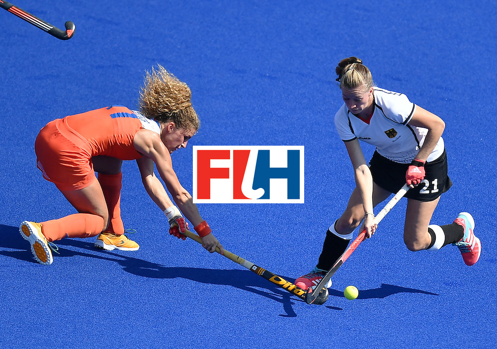 Netherlands' Maria Verschoor (L) vies with Germany's Franzisca Hauke during the women's semifinal field hockey Netherlands vs Germany match of the Rio 2016 Olympics Games at the Olympic Hockey Centre in Rio de Janeiro on August 17, 2016. / AFP / MANAN VATSYAYANA        (Photo credit should read MANAN VATSYAYANA/AFP/Getty Images)