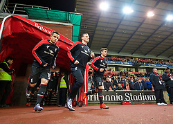 STOKE-ON-TRENT, ENGLAND - Tuesday, January 5, 2016: Liverpool's Philippe Coutinho Correia, Brad Smith and Cameron Brannagan run out to warm-up before the Football League Cup Semi-Final 1st Leg match against Stoke City at the Britannia Stadium. (Pic by David Rawcliffe/Propaganda)
