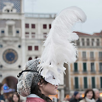 VENICE, ITALY - FEBRUARY 20:   A woman wearing Carnival costume and mask poses in St Mark Square on February 20, 2011 in Venice, Italy. The Venice Carnival, one ofthe largest and most important in Italy, attracts thousands of people from around the world each year. The theme for this year's carnival is Ottocento amd Sissi, a nineteenth century evocation, andwill runfrom February 19 till March 8.