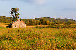 An old farm building in a field next to the Mars Hill wind farm in Mars Hill, Maine. The International Appalachian Trail traverses the ridge on Mars Hill.