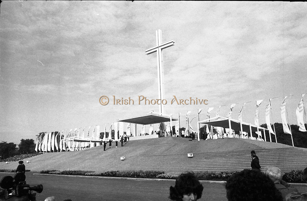Pope John-Paul II visits Ireland..1979..29.09.1979..09.29.1979..29th September 1979..Today marked the historic arrival of Pope John-Paul II to Ireland. He is here on a three day visit to the country with a packed itinerary. He will celebrate mass today at a specially built altar in the Phoenix Park in Dublin. From Dublin he will travel to Drogheda by cavalcade. On the 30th he will host a youth rally in Galway and on the 1st Oct he will host a mass in Limerick prior to his departure from Shannon Airport to the U.S..A view of the specially constructed altar in the Phoenix Park totally dominated by the gigantic Papal Cross.