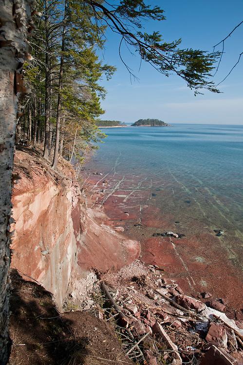 Lake Superior shoreline near Wetmore Landing and Little Presque Isle areas near Marquette Michigan in Michigan's Upper Peninsula.