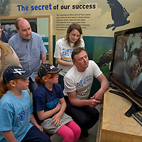 SWT Bird B&B event. Loch of the Lowes Visitor Centre. 5.6.2010.<br /> Pepoles Postcode Lottery family members Tania Kennedy, Ian Murray and kids Rebecca,8,left, and Chelsea  watch the live HD video feed from the Osprey nest with visitor centre manager Peter Ferns and PPL communication assistant Lisa Imlach.<br /> <br /> COPYRIGHT: Perthshire Picture Agency.<br /> Tel. 01738 623350 / 07775 852112.