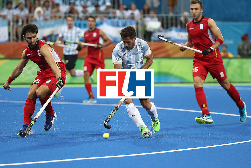 RIO DE JANEIRO, BRAZIL - AUGUST 18:  Agustin Mazzilli #26 of Argentina in action during the Men's Hockey Gold Medal match between Belgium and Argentina on Day 13 of the Rio 2016 Olympic Games at Olympic Hockey Centre on August 18, 2016 in Rio de Janeiro, Brazil.  (Photo by Sean M. Haffey/Getty Images)