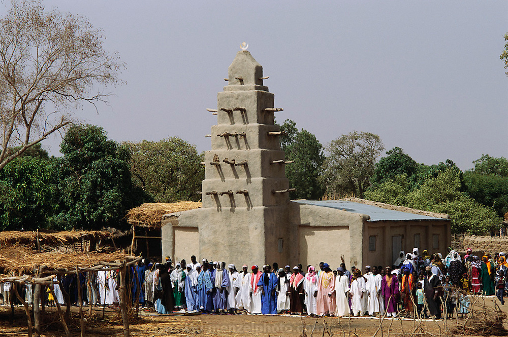 The mud-walled mosque (Muslim) on Friday at mid-day prayers in the W. African town of Tigona, Mali. Material World Project.