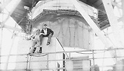 """AMAZING Photo Film discovered Documenting Work In Chernobyl <br />Chernobyl worker Aleksandr Shubovskiy captures rare images <br /><br />During one of the days in 1979-80, when the erection of Ventilation Stack VT-2 common for the third and fourth (not existed at that time) Chernobyl NPP Units was coming to the end, Aleksandr Shubovskiy, who was working within a combined installation crew in a company named """"Spetsenergomontazh"""", arranged with the colleagues a small photo session on his own,They had their pictures taken.<br /><br />The author processed the film and put it on a wardrobe without printing until he had time to print the images. The moment to print the film somehow did not happen, while in February 1986 Aleksandr hit the road for a on a different site in Yakutia. And there he was caught by news about the accident at Chernobyl.<br /><br />A year later, when a Aleksandr  managed to get into his looted flat in the evacuated Pripyat, he discovered an untouched package with films. He brought them home and… forgot for almost 40 years…the printed photographs which no one and never have seen before until now<br /><br />Photo shows: Ventilation Stack (VT-2) dimensions in comparison with a man. The photo captures the view of a workmen's shelter situating on the roof of Power Unit 3.<br />©Aleksandr Shubovskiy/Exclusivepix Media"""
