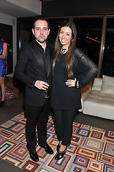 RAFAEL LOPEZ and SOPHIE GITTINS at a private sales evening for Atelier Mayer held at 18 Horbury Crescent, London W11 on 22nd November 2011.