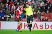 Referee Lee Probert speaks with Aiden McGeady (#19) of Sunderland AFC during the EFL Sky Bet League 1 match between Sunderland AFC and Luton Town at the Stadium Of Light, Sunderland, England on 12 January 2019.