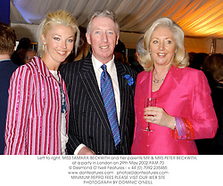 Left to right, MISS TAMARA BECKWITH and her parents MR & MRS PETER BECKWITH, at a party in London on 29th May 2002.	PAM 70