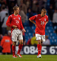 Fotball<br /> Photo. Jed Wee, Digitalsport<br /> NORWAY ONLY<br /> <br /> England v Japan, The FA Summer Tournament, 01/06/2004.<br /> England players Phil Neville (L) and Kieron Dyer reflect the disappointment as England struggle to a 1-1 draw with Japan.