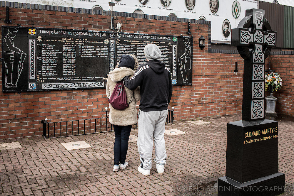 A couple pays homage to the Clonard Martyrs, people who fought and died for the Republican cause in Northern Ireland.