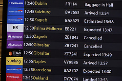 © Licensed to London News Pictures. 02/10/2017. Crawley, UK. An arrivals board shows two cancelled Monarch flights from Zagreb and Gibraltar at Gatwick Airport after it was announced that the airline has ceased trading. The government has announced that it will start the country's biggest ever peacetime repatriation to fly about 110,000 stranded passengers home. Photo credit: Peter Macdiarmid/LNP