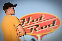 JEROME A. POLLOS/Press..Simon Urlacher stands on top of a utility box as he watches the burnout session Friday at the River City Rod Run in Post Falls.