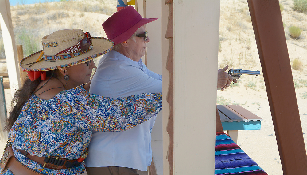 gbs072917k/RIO-WEST --  Instructor Linda Dominguez of Albuquerque, left, helps Maggi Kitts of Albuquerque aim her revolver during the Rio Grande Renegades Ladies Shoot at the Albuquerque Shooting Range on Saturday, July 29, 2017. (Greg Sorber/Albuquerque Journal)
