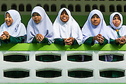 10 JULY 2013 - PATTANI, PATTANI, THAILAND: Girls at a private Muslim school in Pattani. Many Muslim parents prefer to send their children to Muslim private schools because they are safer (public schools have been attacked by Muslim insurgents), the Muslim schools teach an Islam centric curriculum and teach what many in Pattani consider a more accurate version of Pattani history.   PHOTO BY JACK KURTZ