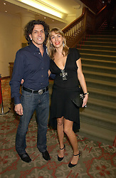 Left to right, STEPHEN & ASSIA WEBSTER, he is the jeweller at the Lighthouse Gala Auction in aid of the Terrence Higgins Trust held at Christie's, St.James's, London on 15th March 2006.<br />