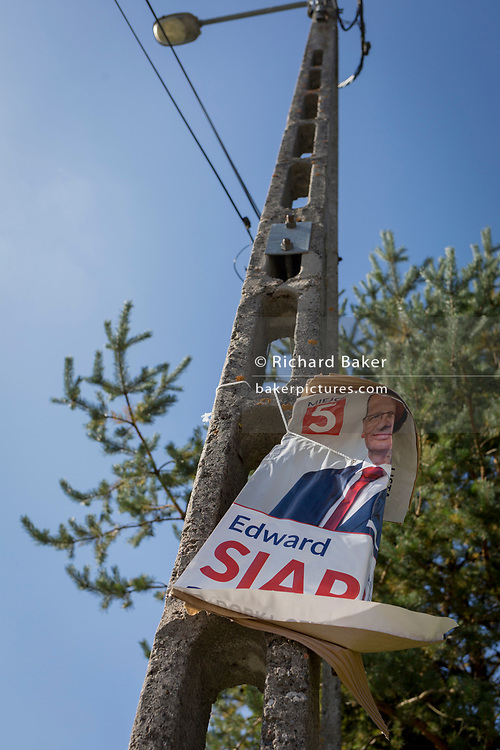 "A torn election poster for a Polish political candidate, on 21st September 2019, in Jaworki, near Szczawnica, Malopolska, Poland. Poland's parliamentary elections will be held on 13 October 2019 when all 460 members of the Sejm and 100 senators will be elected. The Sejm of the Republic of Poland is the lower house of the Polish parliament. It consists of 460 deputies elected by universal ballot and is presided over by a speaker called the ""Marshal of the Sejm of the Republic of Poland"""