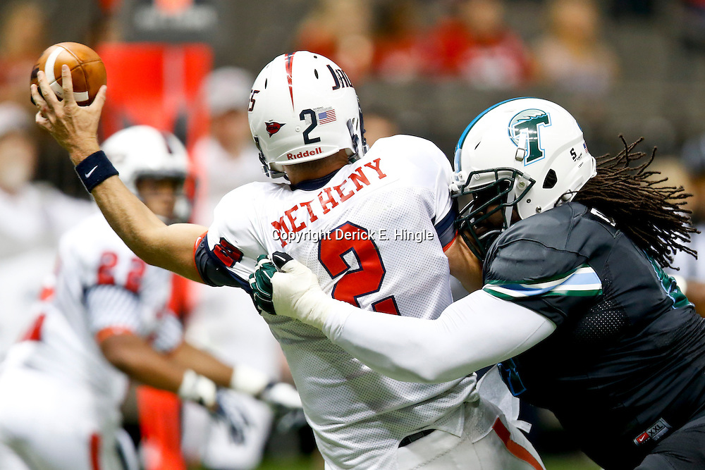 Sep 7, 2013; New Orleans, LA, USA; Tulane Green Wave defensive tackle Chris Davenport (94) pressures South Alabama Jaguars quarterback Ross Metheny (2) to throw during the second half of a game at the Mercedes-Benz Superdome. South Alabama defeated Tulane 41-39. Mandatory Credit: Derick E. Hingle-USA TODAY Sports