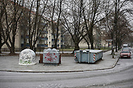 A recycling facility covered with graffiti standing on the site of the former Berlin Wall, in Gesundbrunnen, a district of northern Berlin. The route of the Wall, which stood from 1962-1989, has been developed into the 'Mauerweg,' a thoroughfare which traces most of the route of the Wall which encircled the city and divided it into East and West Berlin during the Cold War. In the years following the 1989 civil uprising in the German Democratic Republic, most of the Wall was removed as part of the reunification strategy which united the pro-Soviet DDR and the Federal Republic of (West) Germany.