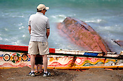 """Tenerife / Los Cristianos June 7, 2006 - A fishing boat called """"Cayucos"""" , is found on the beach  - A fishing boat called """"Cayucos"""" by the inhabitants of the island, with 85 would-be immigrants from West Africa intercepted by Spanish police of the coast of Tenerife in the Canary Islands are seen in an open wooden fishing vessel as they approach the port of Los Cristianos. They arrived on June, carrying 85 would-be immigrants, in the archipelago which has received more than 7,000 Africans so far this year, more than half to the tourist resort island of Tenerife. At least 1,000 more are believed to have died trying to make the sea crossing, mostly in small fishing boats"""