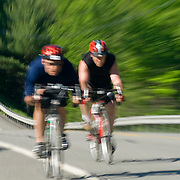 Two male cyclists wearing red helmets travel at great speed.  The 2007 Trek Across Maine, an annual project of the American Lung Association of Maine (ALAM).
