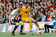 Preston North End defender Greg Cunningham (3) keeps the ball away from Brentford midfielder Lewis Macleod (4) during the EFL Sky Bet Championship match between Brentford and Preston North End at Griffin Park, London, England on 17 September 2016. Photo by Andy Walter.