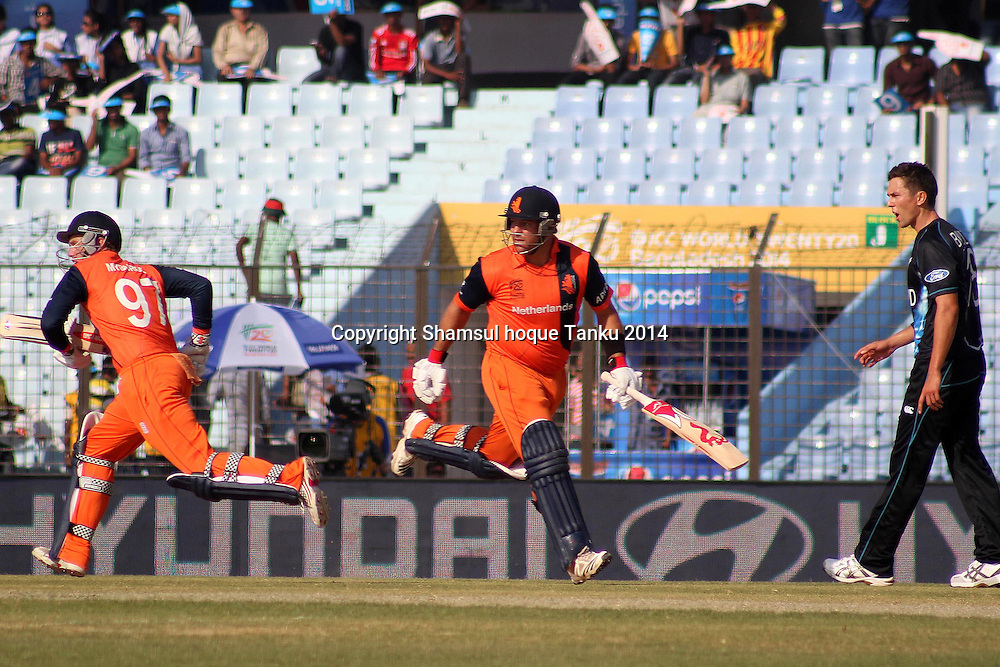 Stephan Myburgh and Michael Swart running between wickets - New Zealand Black Caps v Netherlands, Zahur Ahmed Chowdhury Stadium, Chittagong, Bangladesh. ICC World Twenty20 cricket Bangaldesh 2014. 29 March 2014. Photo: Shamsul hoque Tanku/www.photosport.co.nz