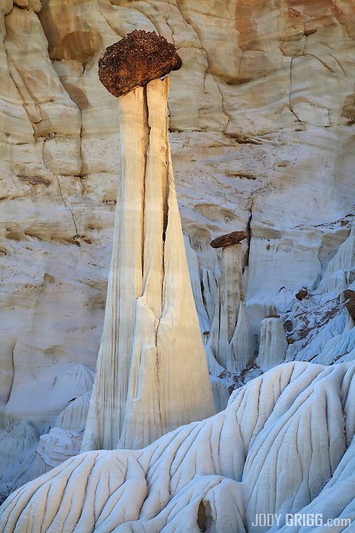 Wahweap Hoodoos are entrada sandstone pillars with dakota sandstone toppers located in the Grand Staircase-Escanlante National Monument near Big Water, Utah.
