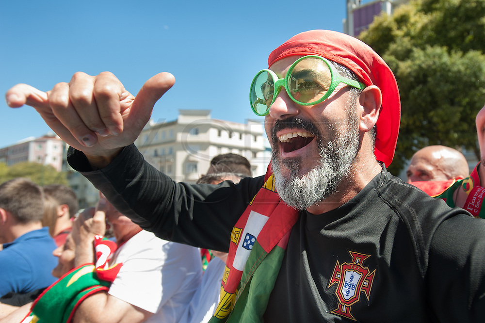 portuguese supporters at Alameda Dom Afonso Henriques, in Lisbon. Portugal's national squad won the Euro Cup the day before, beating in the final France, the organizing country of the European Football Championship, in a match that ended 1-0 after extra-time.
