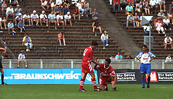BERLIN, GERMANY - Sunday, August 7, 1994: Liverpool's Robbie Fowler (L) helps up team-mate Ian Rush during a preseason friendly between Hertha BSC Berlin and Liverpool FC at the Olympiastadion. Liverpool won 3-0. (Pic by David Rawcliffe/Propaganda)