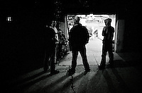 A group of Danger Room friends stand outside in the alley and talk during a night at the Danger Room.........