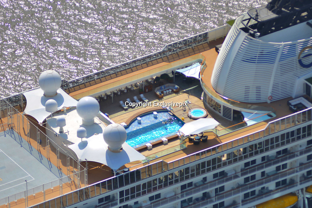 "SHANGHAI, CHINA - OCTOBER 28: (CHINA OUT) <br /> <br /> World's Largest Luxury Cruise Arrives In Shanghai<br /> <br /> Swimming pool on one of the world's largest luxury cruise called The World arrives at Shanghai port on October 28, 2014 in Shanghai, China. One of the world's largest personal luxury cruise called ""The World"" contains 198 cabins and 165 luxurious apartment. <br /> ©Exclusivepix"
